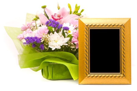 Beautiful bouquet and golden frame on a white photo