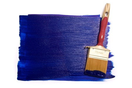 Professional brush with blue paint on the white background photo