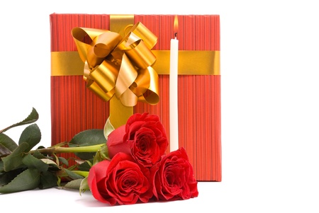 Red roses and gift boxes on a studio white background. photo