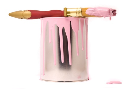 Can of pink paint and professional brush on a white photo