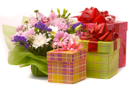 Magnificent bouquet and present boxes on a white  photo