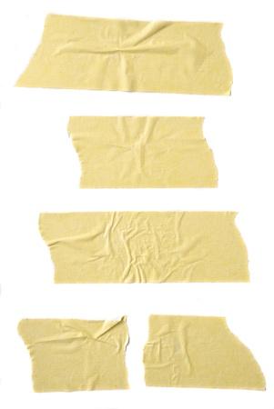 adhesive tape: Strips of masking tape isolated on white background.