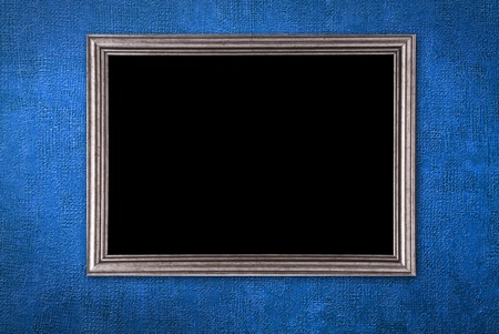 baroque picture frame: Silver frame on a old blue wall background Stock Photo