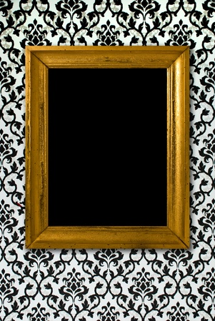 Gold frame on a black and white wallpaper Stock Photo - 10901986