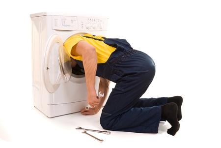 machine man: Repairman and washing machine isolated on white background