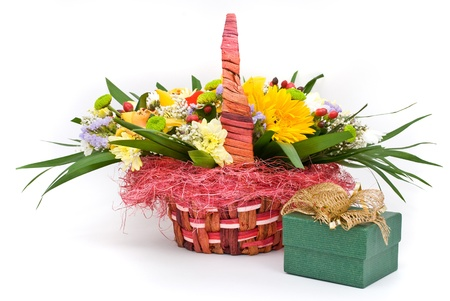 Beautiful bouquet in the basket and present box on a white background photo