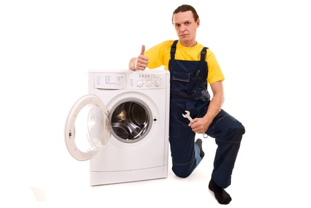 black appliances: Repairman and washing machine isolated on white background