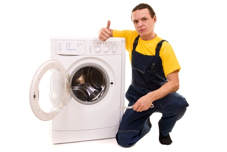 Repairman and washing machine isolated on white background photo