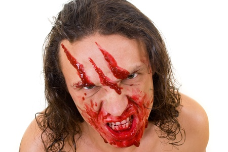 Cannibal maniac with blood on face photo