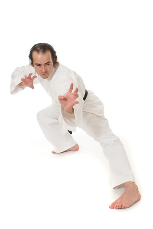 black belt: Karate fighter on white background Stock Photo