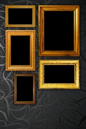 Gold frame on black vintage wallpaper background Stock Photo - 11558557