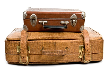 Old suitcases isolated on a white background photo