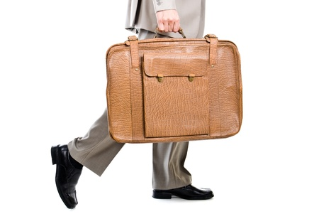 Walking man holding an old suitcase isolated over white background Stock Photo - 11558504