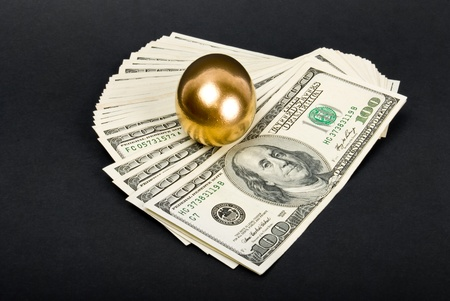Golden eggs. A symbol of making money and successful investment on black background photo