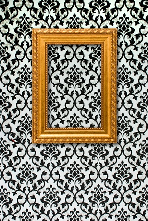 Gold frame on a black and white wallpaper Stock Photo - 11877821