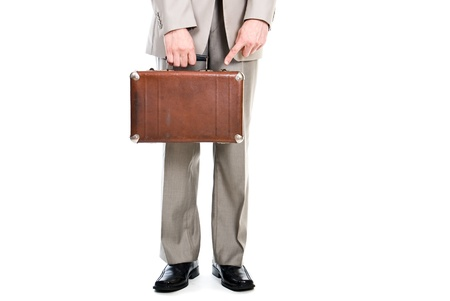 Man holding an old suitcase isolated over white background photo