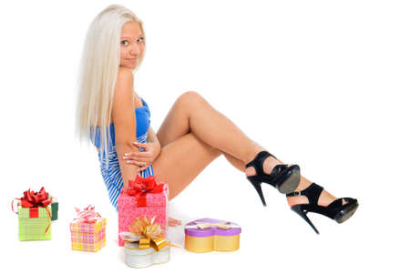 sexy birthday: Beautiful sexy blond woman in blue dress with present boxes on white background Stock Photo