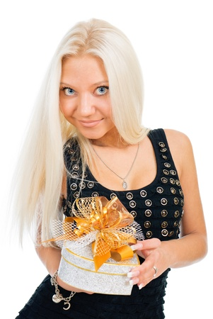 Blonde woman holding gift box over white background photo
