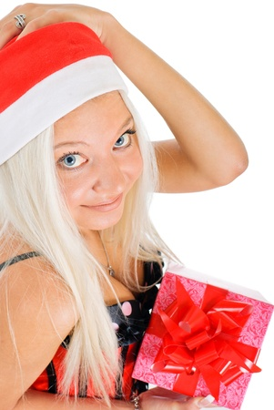 Sexy young blond woman wearing a corset and a Santa's hat with Christmas presents on white background Stock Photo - 12897383