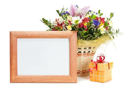 Gift box and wooden picture frame with flowers on white background  photo
