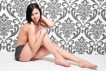 Fashion portrait nude elegant woman on vintage wallpaper background photo