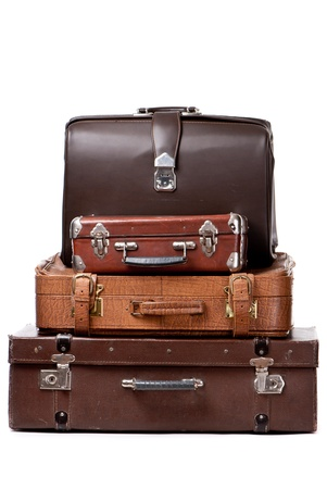 antique suitcase: Old suitcases isolated on a white background