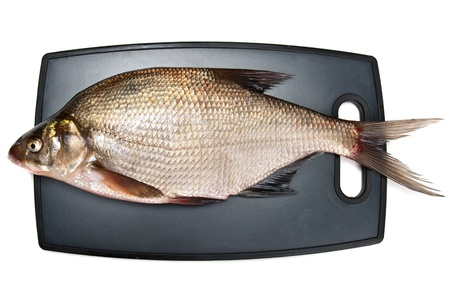 Fresh fish bream on a cutting board on a white background Stock Photo - 15205335