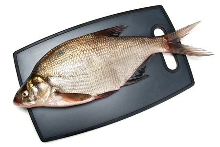 Fresh fish bream on a cutting board on a white background Stock Photo - 15205334