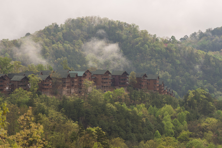Foggy view of cabins of  a cloudy early morning in the Great Smokey Mountains, Tennessee. Stock fotó