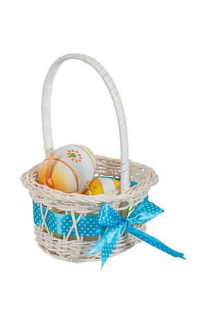 Easter eggs in a basket isolated on white.