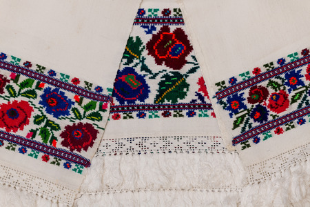 Closeup of Eastern European embroidery design with floral motifs found on towels and clothing.