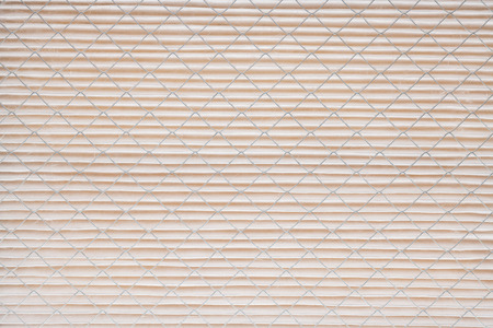 Close up pattern of a clean air furnace or air conditioning filter.