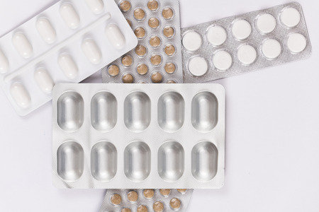 Group of a few prescription pills plates or packages isolated on a white background. Imagens