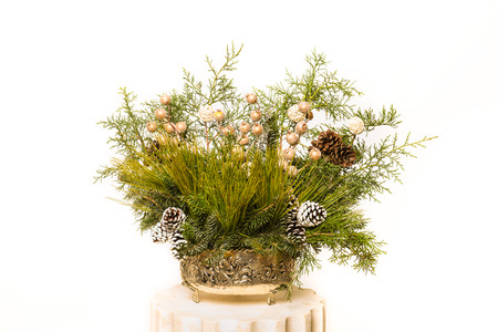 Christmas festive decoration with red baubles, holly with red berries, snow covered pine cones and winter greenery isolated on white