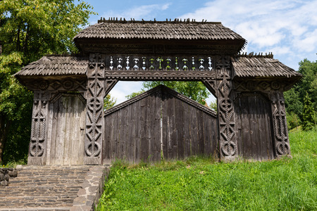 Barsana Monastery Architectural Detail - Traditional Wooden Carved Gate (Maramures, Romania). 写真素材