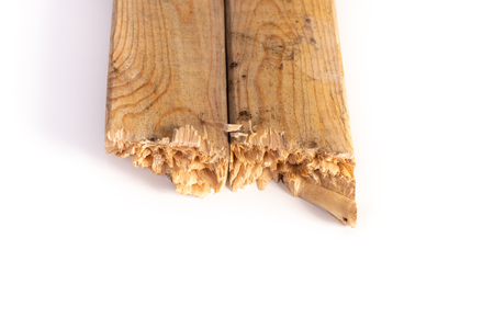 Fractured wood stud used in construction, endurance concept.