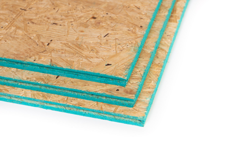 Sub flooring boards made of wood chips isolated on a white with copy space.