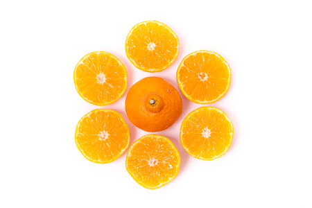 Top view of round cut slices of ripe juicy organic mandarin oranges on a white background. Vitamins healthy lifestyle vegan super foods concept. Standard-Bild