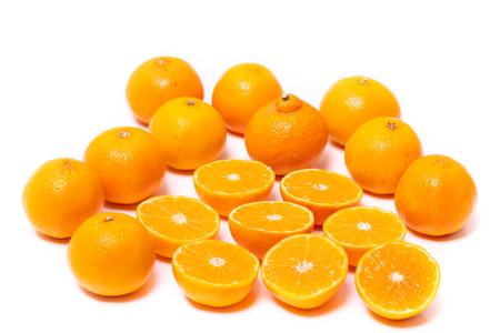 Set of round cut slices of ripe juicy organic mandarin oranges on a white background. Vitamins healthy lifestyle vegan super foods concept. Standard-Bild