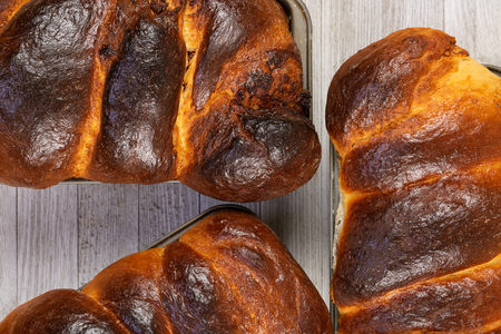 Traditional sweet Easter Holiday bread in baking pan, top view. Stock Photo