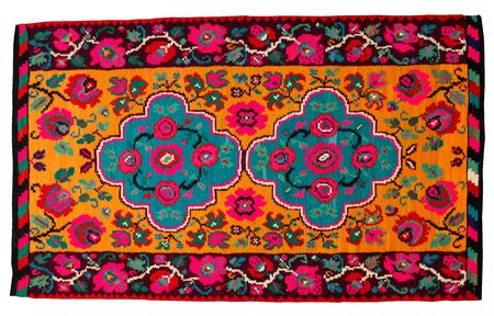 Vintage handmade rug with geometrical shapes and motifs traditional of Maramures region of Romania on a white background.