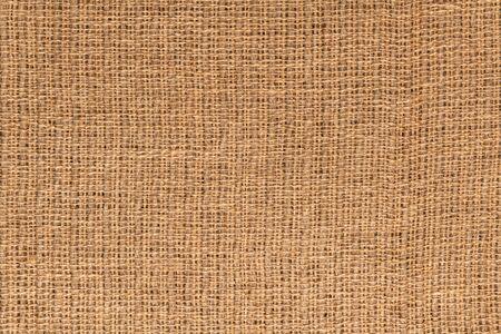 Imagen macro de tela de yute natural o saco de arpillera para usar como fondo o textura. Foto de archivo