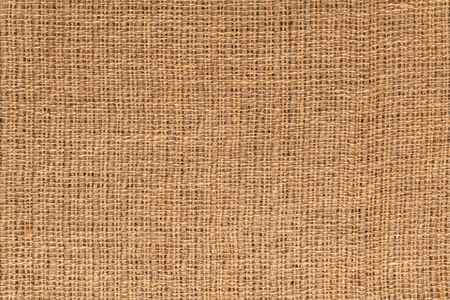Macro picture of natural jute fabric or burlap sack to use as background or texture. Stock Photo