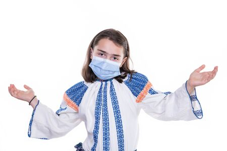 Girl wearing protective medical facial mask isolated on a white background. 免版税图像