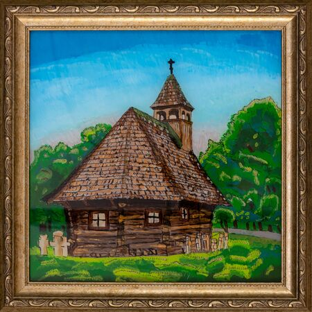 A frame painting on reverse glass depicting a wooden church typical of Maramures region of Romania. 写真素材