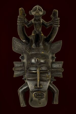 Senufo mask from West Africa, carved in wood isolated on black 写真素材