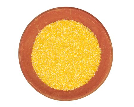 Food texture background of maize flour, top view in terracotta red plate.