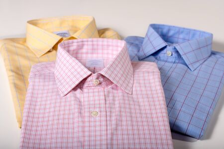 Men shirts folded and pressed. Business wear. Men dress shirts. Men Cloth.