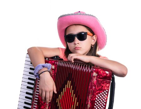 Young preteen girl  with accordion isolated on a white background.