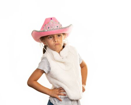 Young girl in cowboy hat posing on a white background. 写真素材